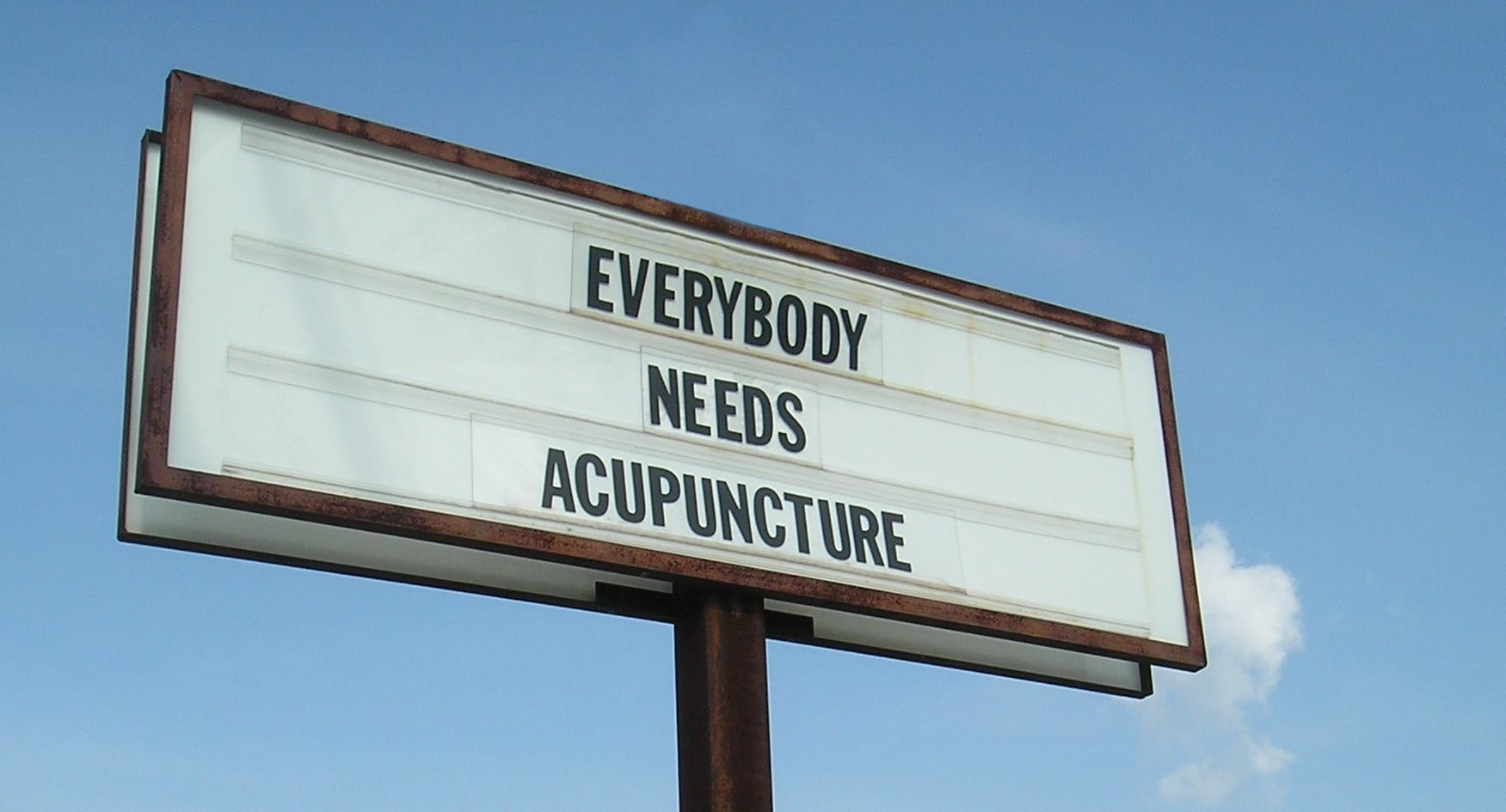 """Everybody Needs Acupuncture"" marquee from our original South Lamar location"